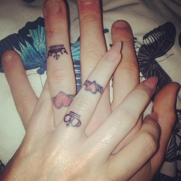 Tiny Crowns Matching Tattoos On Fingers.