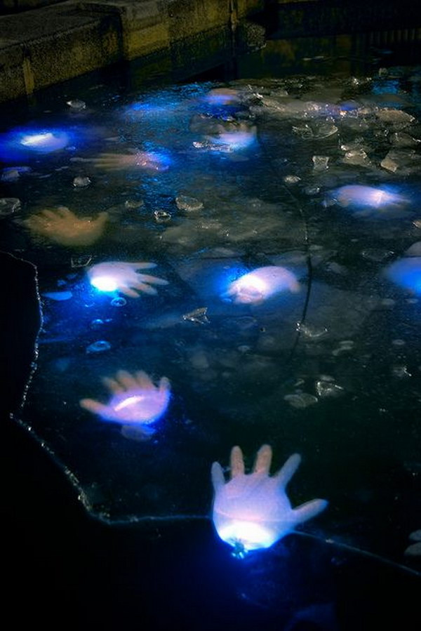 Creepy Pond Idea Using Latex Gloves with Glow Sticks.