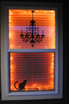 Easy Spooky Scene from a Chandelier Decal and a Black Cat Silhouette.