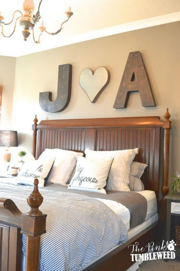 Bold Initials Above the Bed.