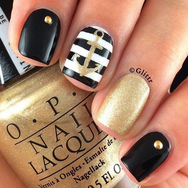Black, White and Gold Anchor Manicure Design.