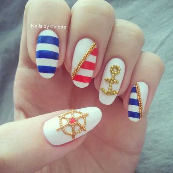 Gold Studded Anchor and Wheel Nautical Manicure.