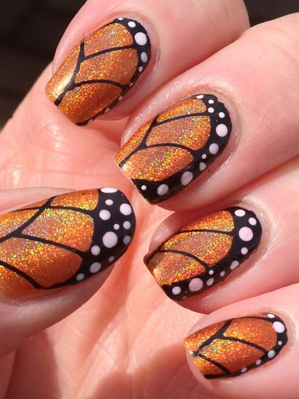 Orange Glitter Butterfly Nail Design. Get the tutorial