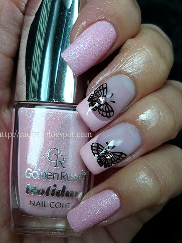 Pink Nails Accented with Black Butterflies.