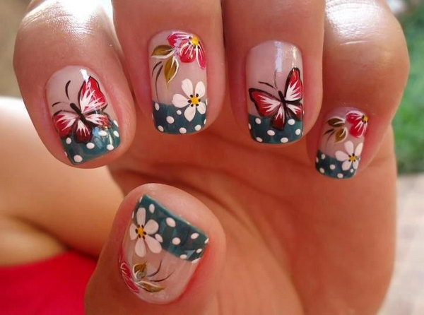 Dark Blue & White Polka Dot French Tip Manicure with Butterflies and Flowers.