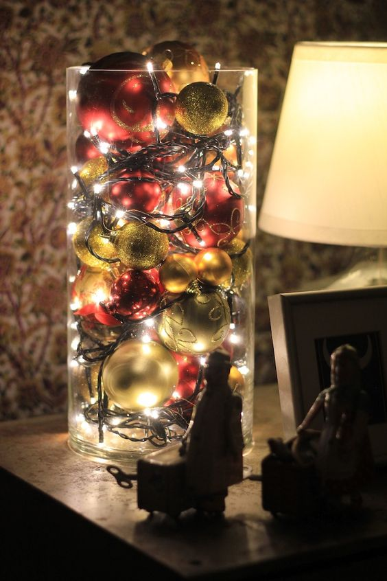 Ornaments and Christmas Lights in a Glass Vase.