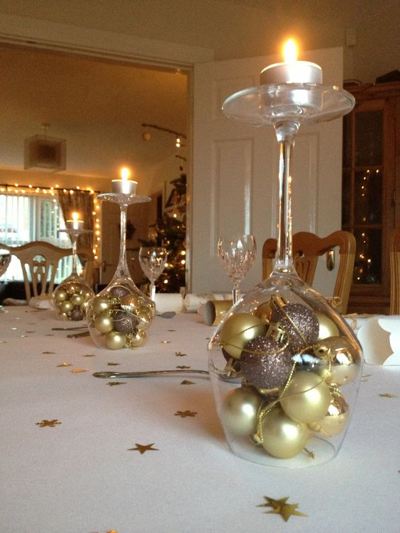Fill Wine Glasses With Ornaments And Place Them Upside Down As Candle Holders.