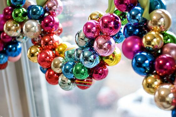 Thread Ornaments Onto A Ribbon For Window Decoration.