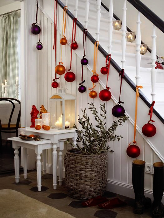 Fresh Festive Christmas Staircase with Ornaments Hanging from the Balusters.