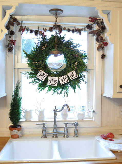 Kitchen Window Decorated with Christmas Wreath.
