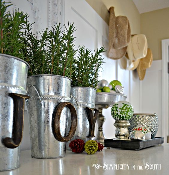 Hobby Lobby Letters Hot Glued onto Buckets with Rosemary Clippings.