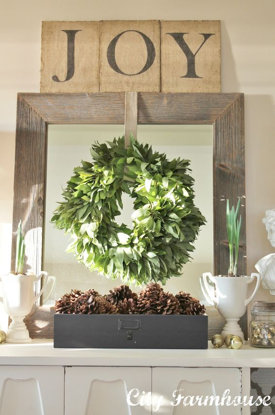 Hang Wreaths from an Framed Mirror.