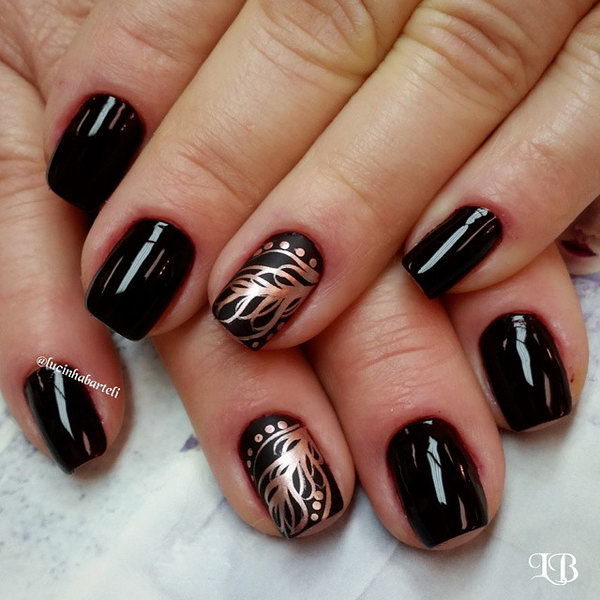 Golden Feather Nail Art. Very pretty! I have to say, I am really into this feather design.