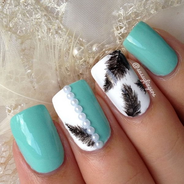 Green and White Nail Design with Feather and Pearls. Very pretty! I have to say, I am really into this feather design.