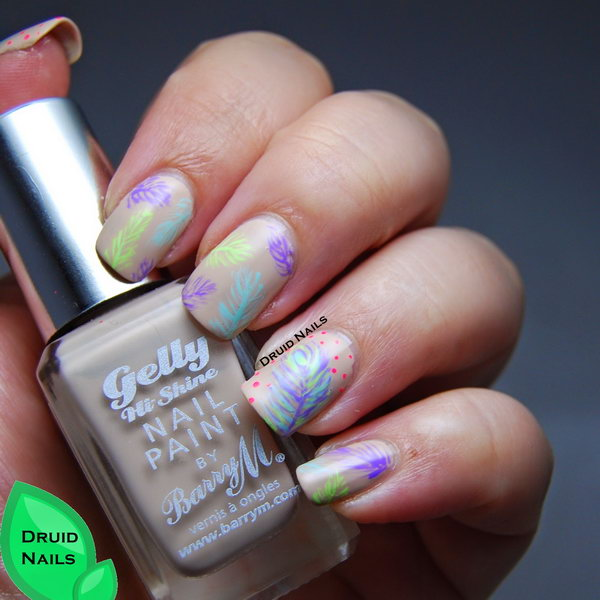 Neon Feather Nail Art. Very pretty! I have to say, I am really into this feather design.