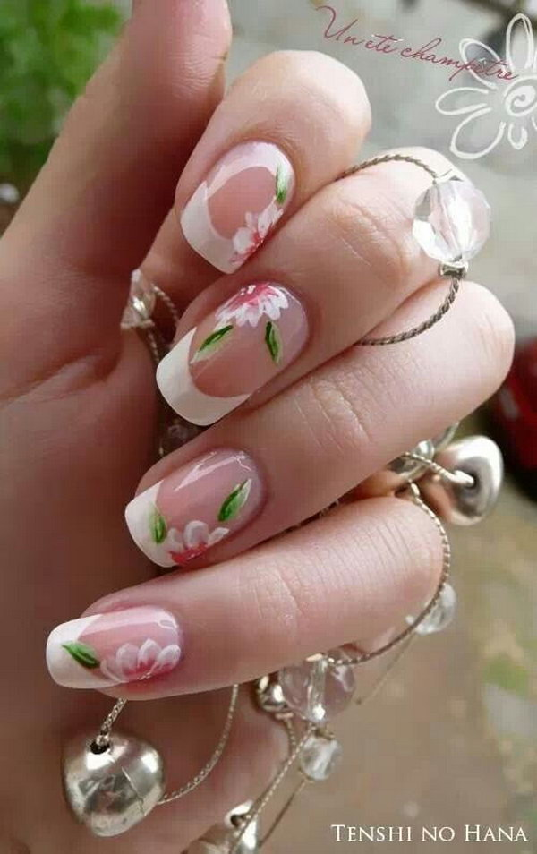 Clear French Manicure Accented with Abloom Flowers.