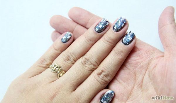 DIY Galaxy Nail Art. Get the tutorial