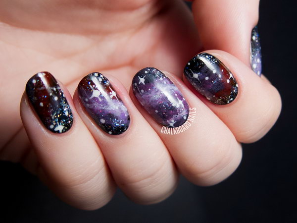 Purple Galaxy Nails. Get the tutorial