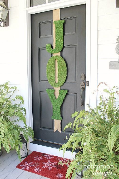 diy mossy joy banner on the front door - Joy Christmas Decoration