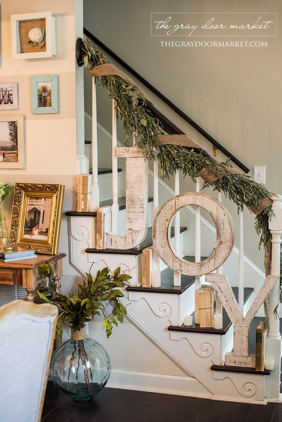 Rustic Farmhouse Style Holiday Staircase Decor with Large Letters JOY Spelled Out.