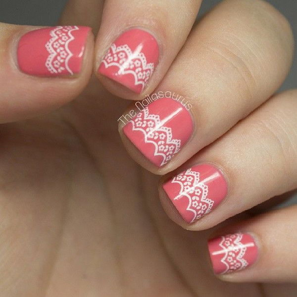 Coral Background and White Lace Nails.