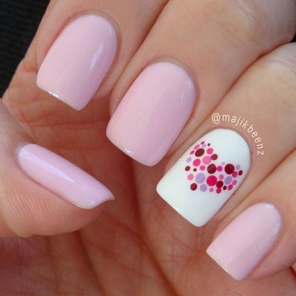 Sweetheart Nail Art. We're obsessed with the fresh color scheme and the heart shape on the nails.