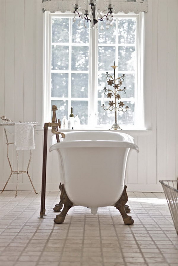 All White Shabby Chic Bathroom With A Tub In The Middle