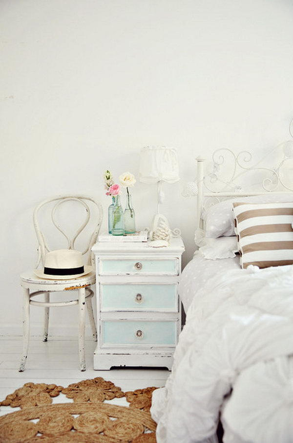 White Walls and Light Hardwood Floors Shabby Chic Bedroom.