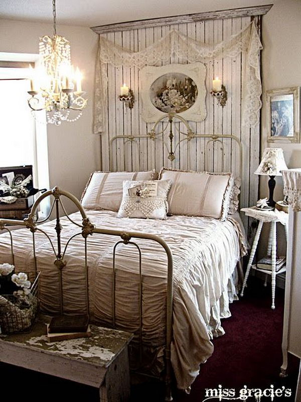 This is an example of a romantic shabby chic style bedroom with the chandelier and the beadboard panel behind the bed.