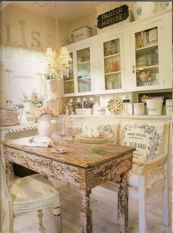Shabby Chic Eat in Kitchen with a Rustic Wood Dinning Table.