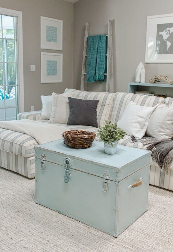Shabby Chic Living Room with Pastel Blue Coffee Table Trunks and Striped Sectional