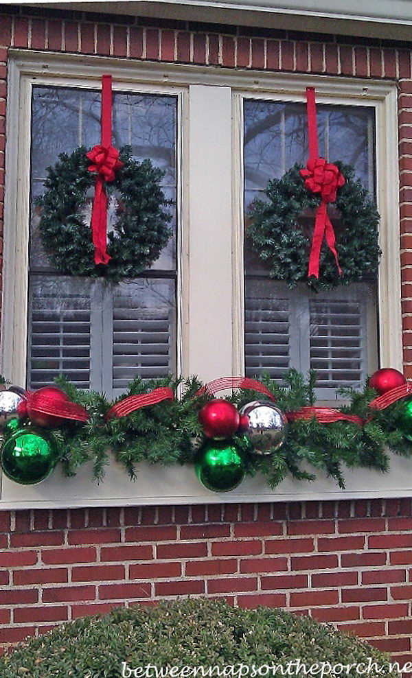 Hanging Wreaths on Windows.