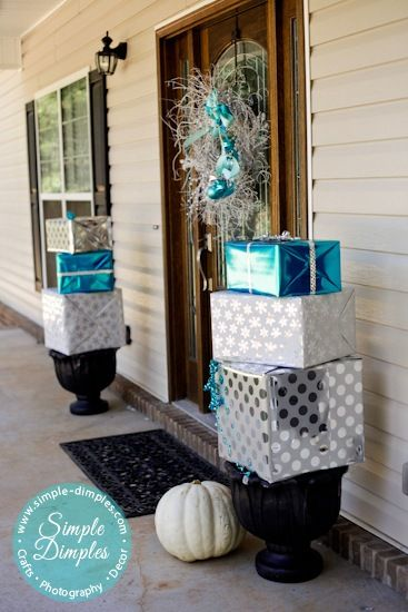 branch wreath and wrapped boxes on planters - Blue And White Outdoor Christmas Decorations