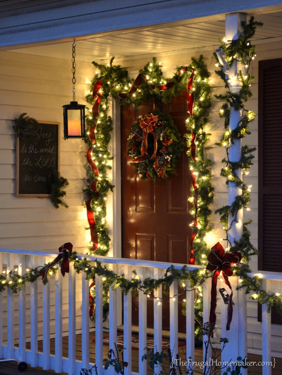 Christmas Front Porch with Hanging Candle Lanterns.