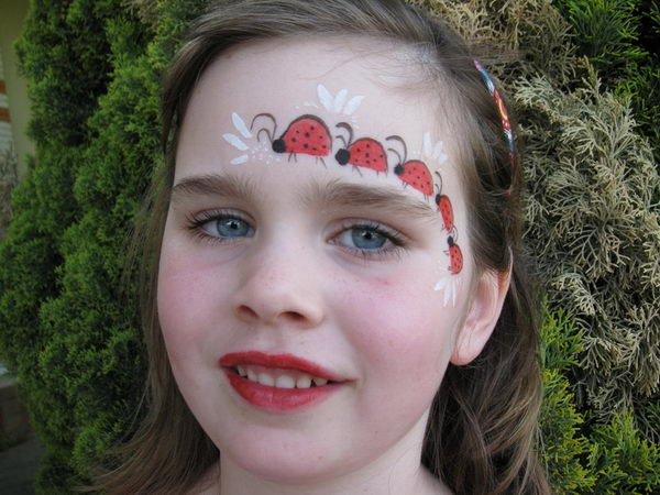 Lady Bugs Face Painting.