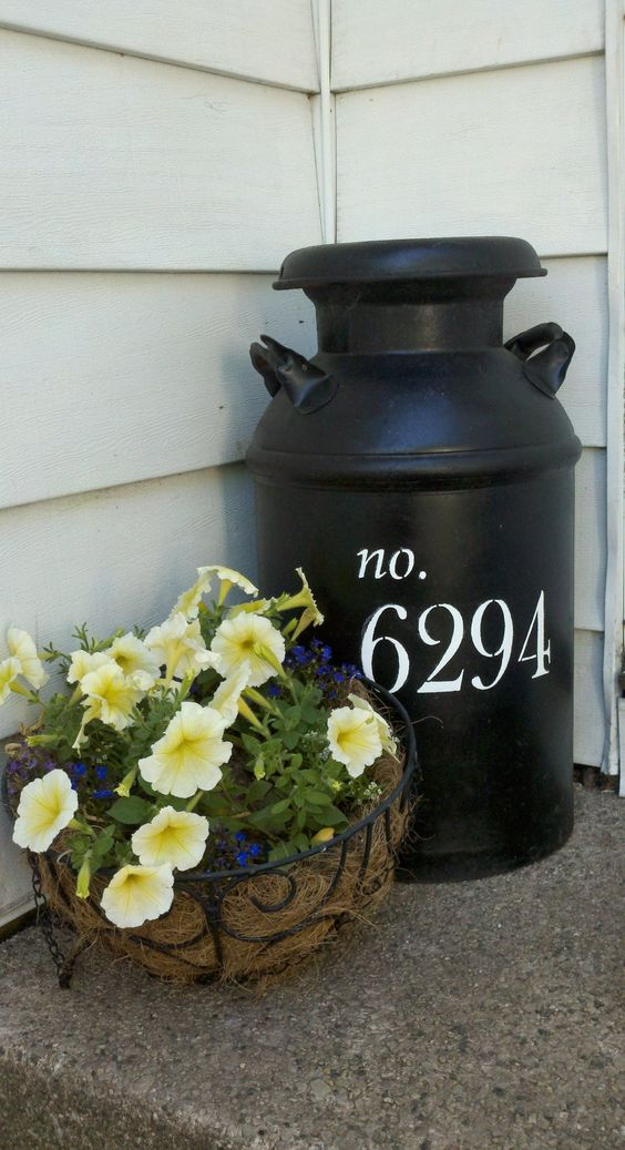 Milk Jug Painted With House Numbers.