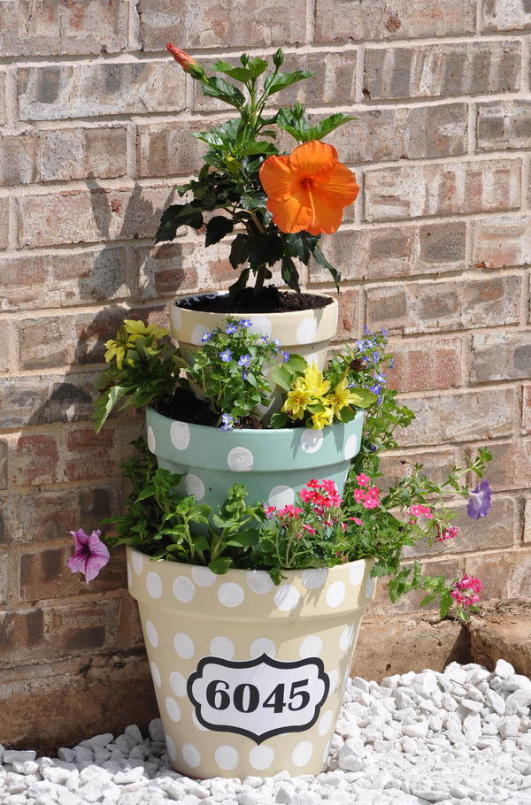 Polka Dotted Flower Pot Tower With House Numbers.