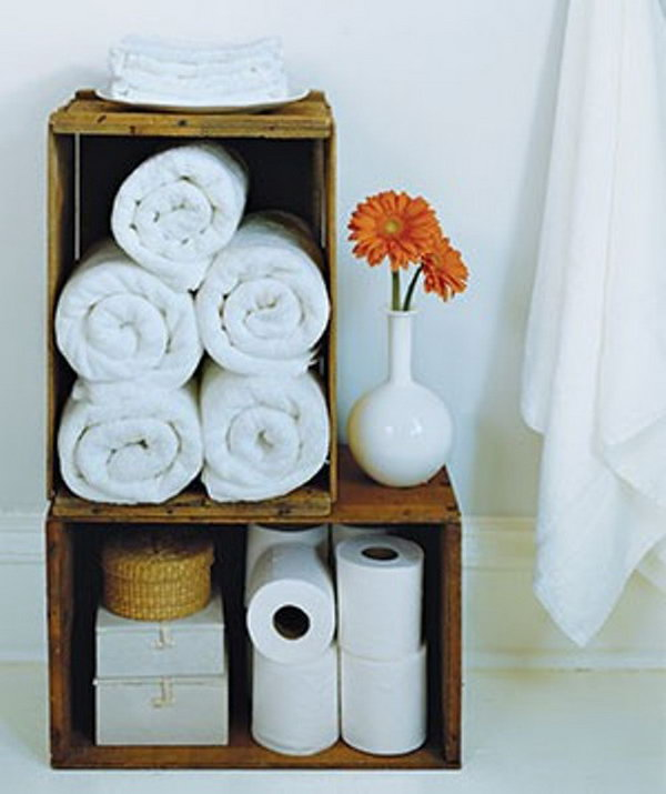Old wood wine crates have a natural vintage charm, and make smart holders for extra toilet paper and rolled bath towels.