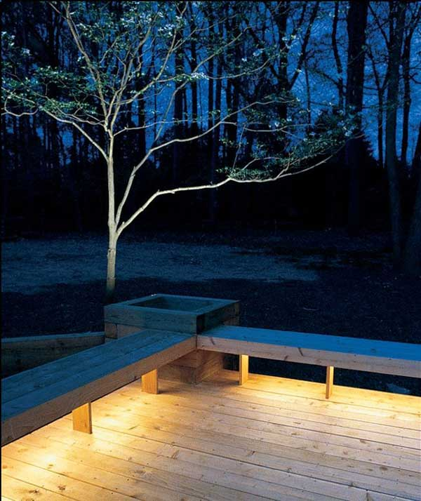Installing lights under benches.
