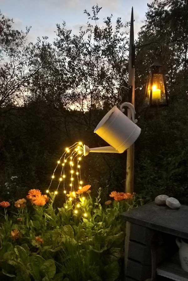 Your garden flowers can enjoy lighting drops from this repurposed watering can.