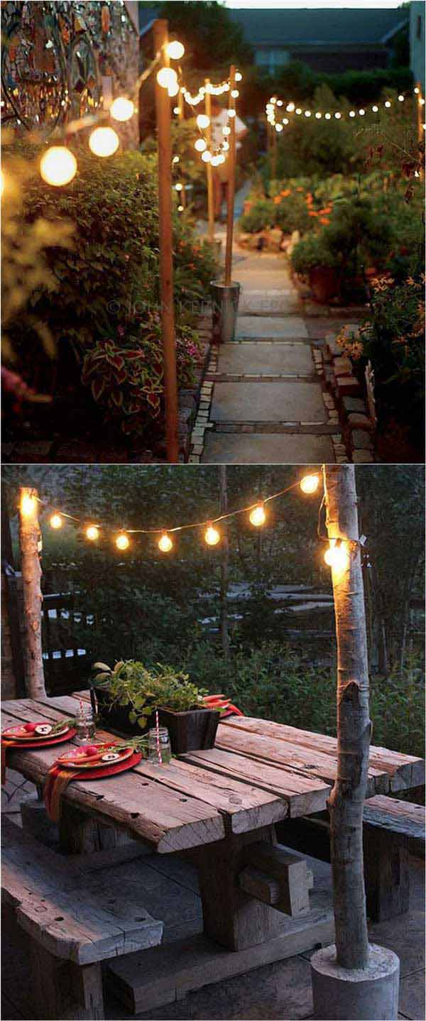 String up some outdoor lights by using a cement base with tree poles added into the cement.
