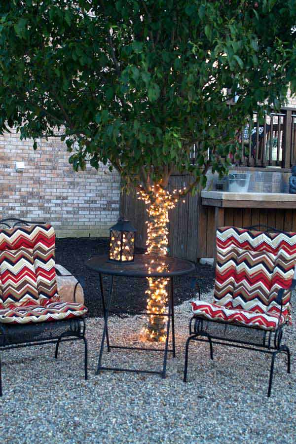 Cover a backyard tree trunk with fairy lights.