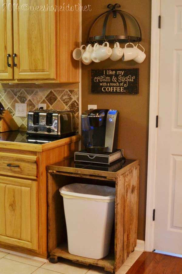 Set up a coffee station above a trash can cabinet made with wooden pallets.