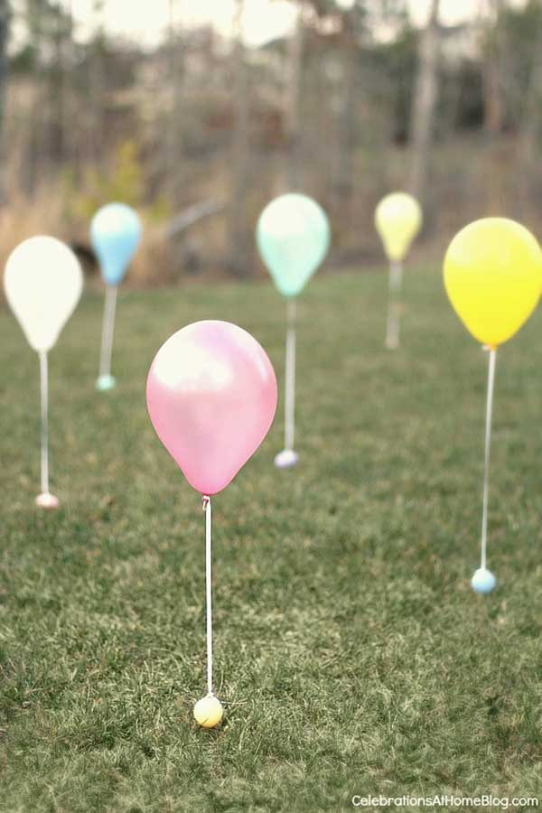 Easter egg hunt is an interesting tradition that every child love. This is a creative egg hunt idea. The secret is helium filled balloons.