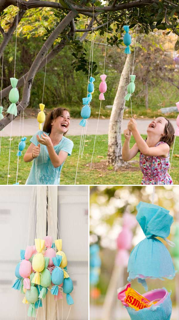 Turn the plastic eggs into candy filled poppers, and then hang them on a outdoor tree and let children pull and pop, gathering candy as they go.