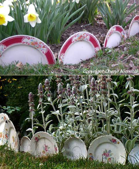 Garden beds edged with old china plates.