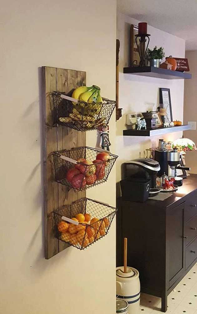 Use reclaimed wood and baskets to create the wall storage of fresh produce.